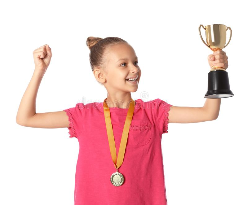 Girl with golden winning cup and medal on white background. Happy girl with golden winning cup and medal on white background royalty free stock image
