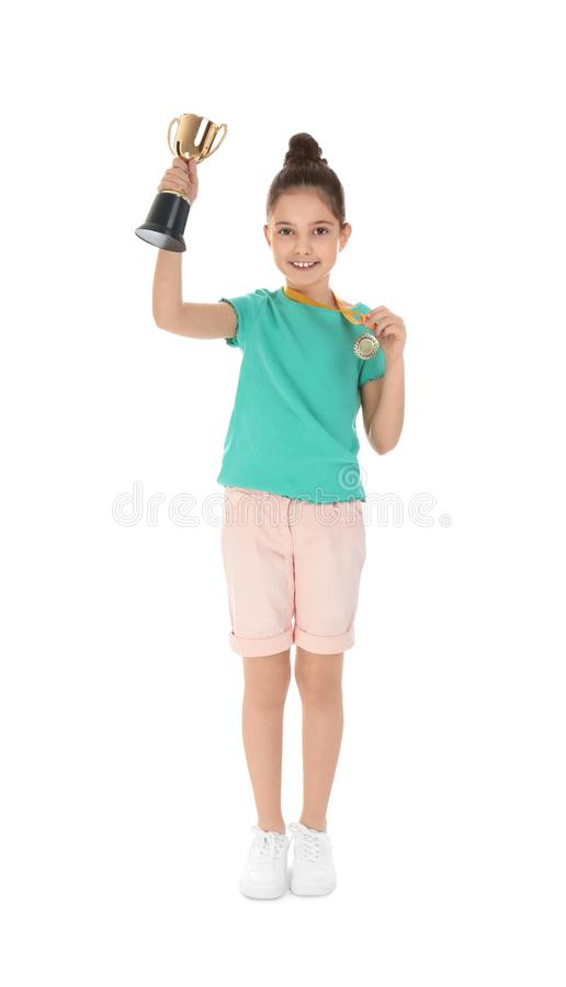Happy girl with golden winning cup and medal on white. Happy girl with golden winning cup and medal isolated on white stock images