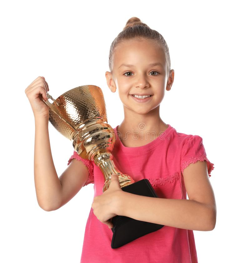 Happy girl with golden winning cup on  background. Happy girl with golden winning cup on white background royalty free stock images