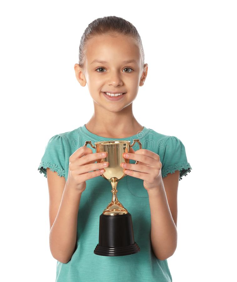 Happy girl with golden winning cup on white. Background stock photo