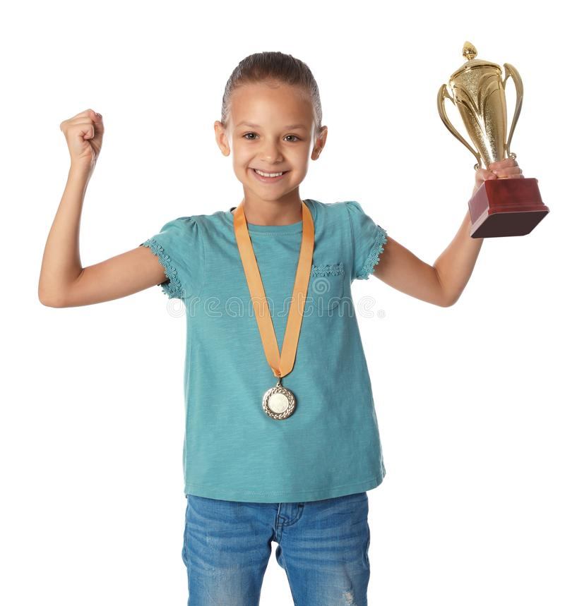 Happy girl with golden winning cup and  on white background. Happy girl with golden winning cup and medal on white background stock photo