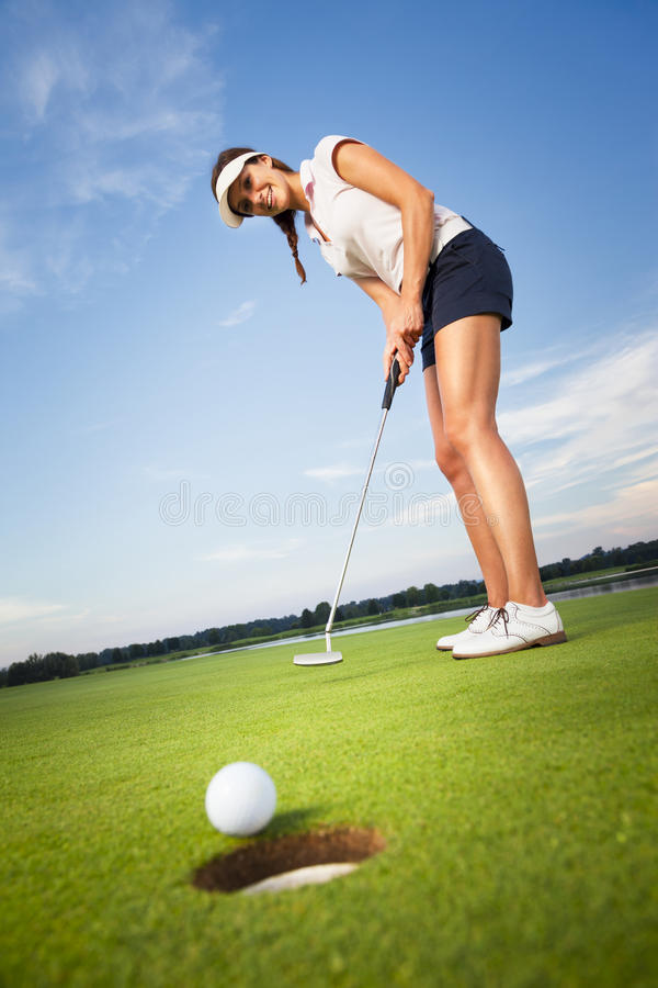 Download Happy Girl Golfer Putting Ball Into Hole. Stock Image - Image: 26802623