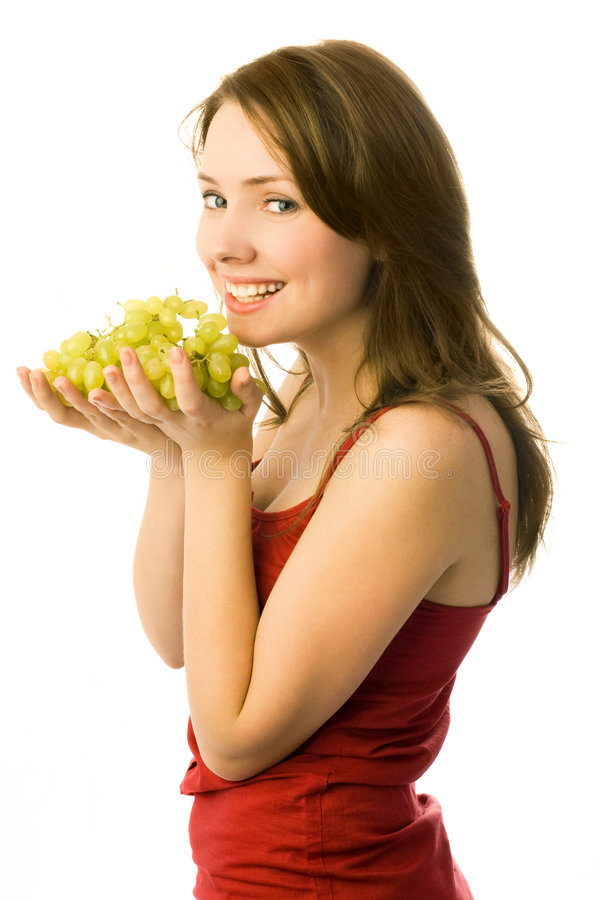 Happy girl with grapes royalty free stock photography