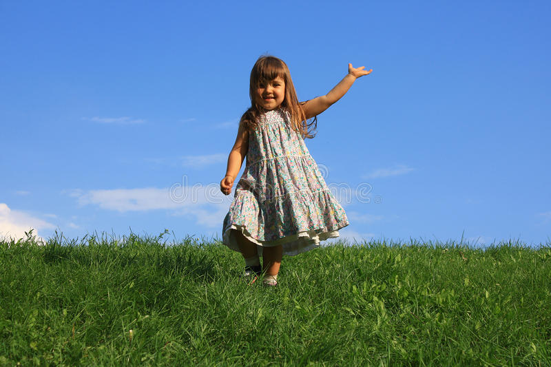 Happy girl on the grass royalty free stock photography