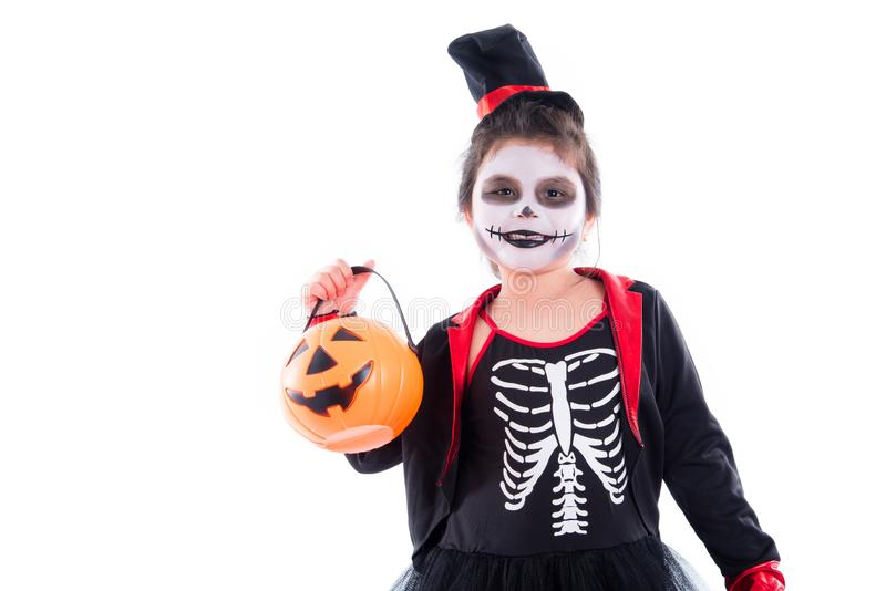 Happy girl in halloween skeleton costume over white. Happy asian girl in halloween skeleton costume isolated over white background royalty free stock photos