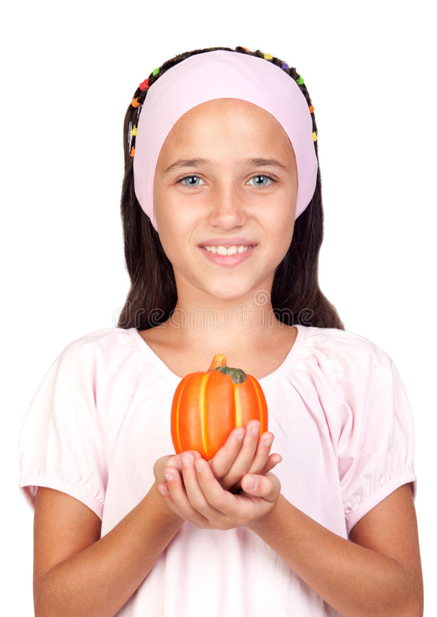 Happy girl in Halloween with a small pumpkin royalty free stock images