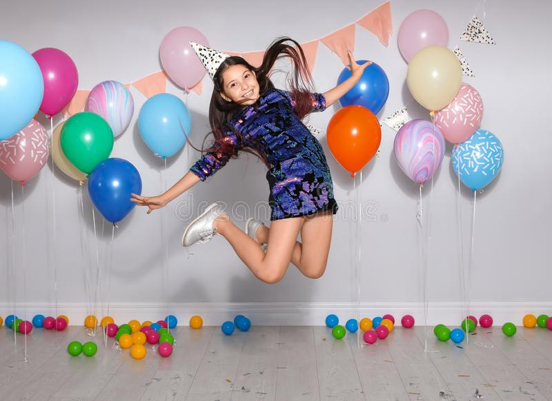 Happy girl having fun at birthday party royalty free stock photo