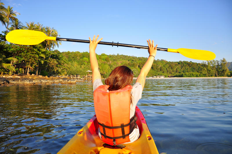 Happy girl having fun on kayak stock images