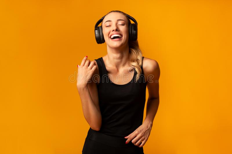 Happy Girl In Headphones Listening To Music Dancing, Studio Shot royalty free stock images