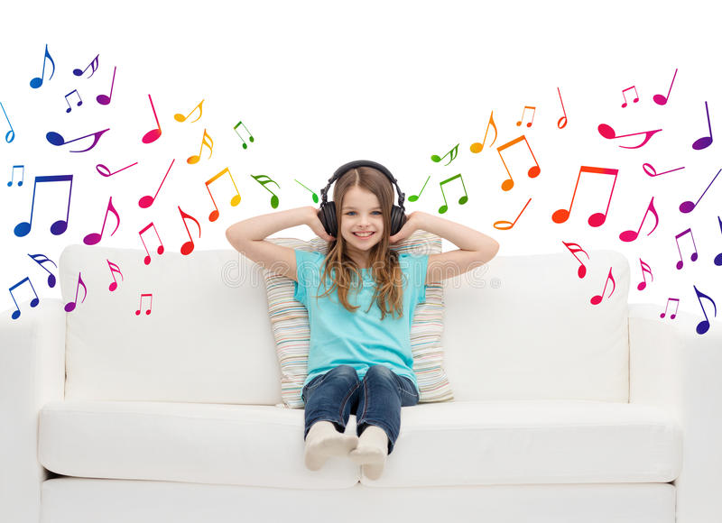 Happy girl in headphones listening to music stock images
