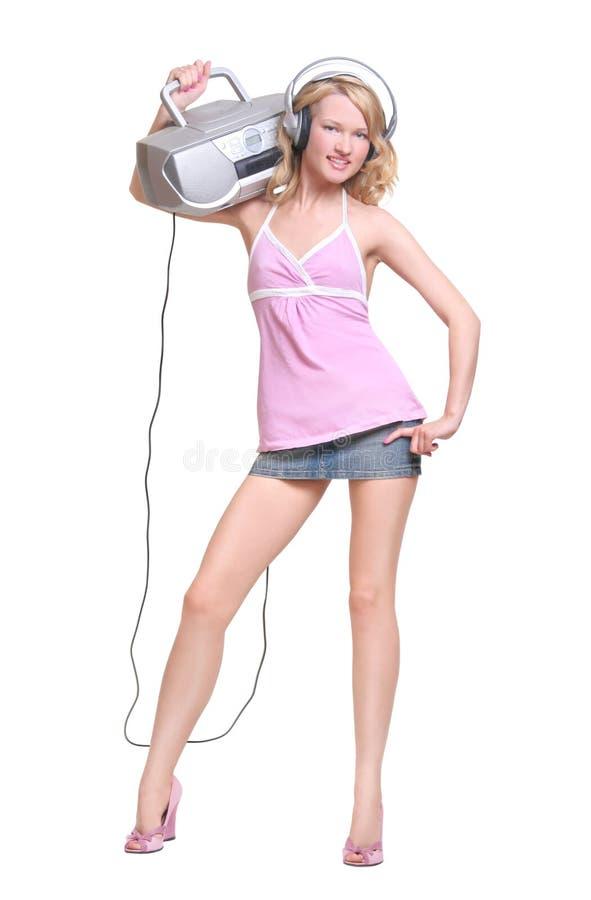 Happy girl with headphones and music boombox stock photo