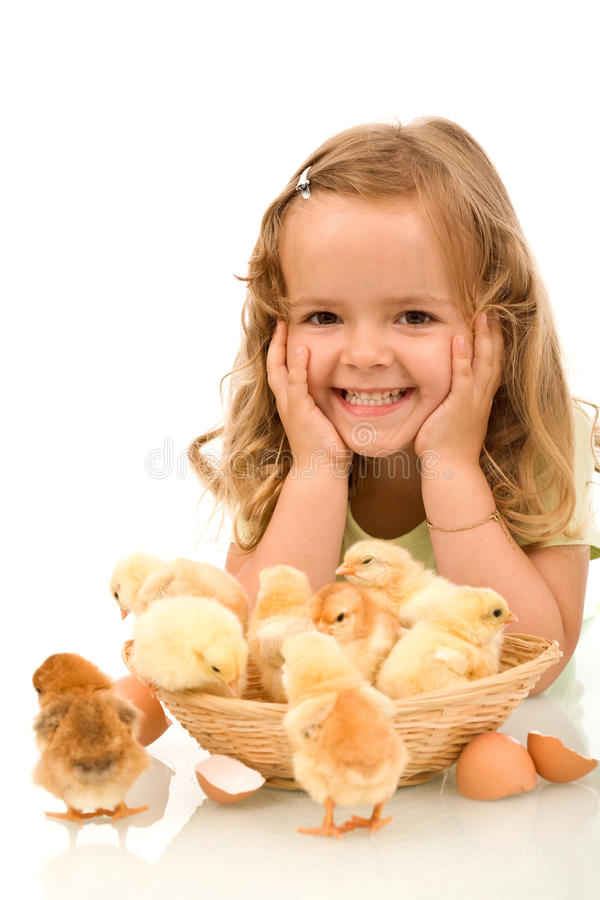 Happy girl with her little chickens royalty free stock image