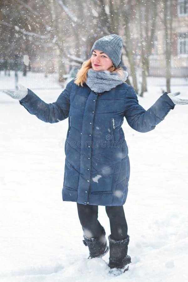Happy girl in her yard in winter stock image