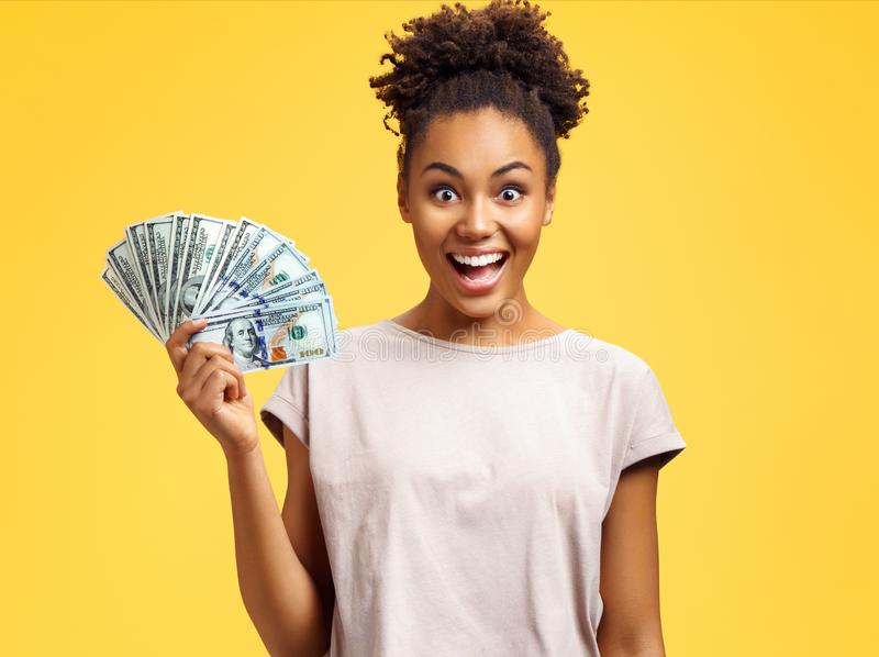 Happy girl holds cash money. stock images