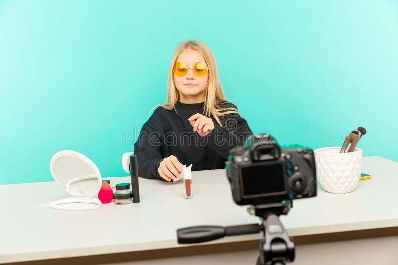 Happy girl at home speaking in front of camera for vlog. Young black woman working as blogger, recording video tutorial stock photos