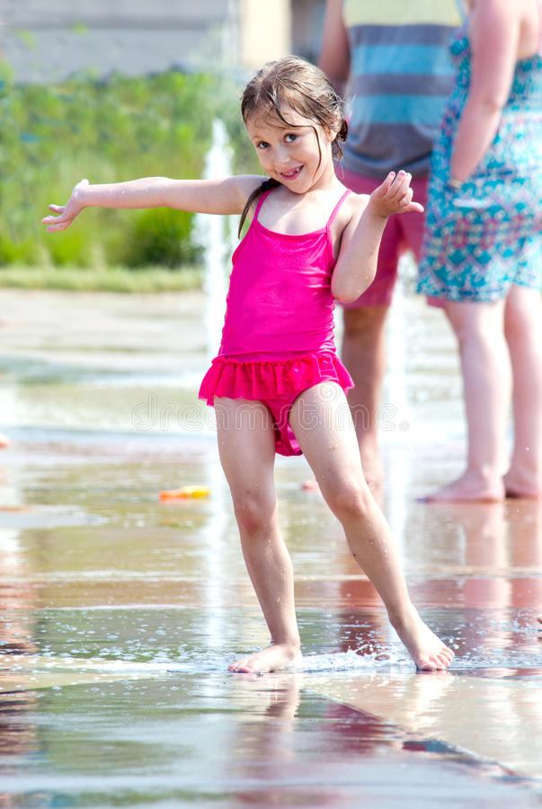 Happy Girl Invites You To Splash Stock Photo - Image Of Active, Person -7311