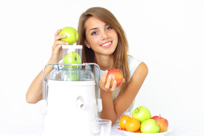 Happy girl about juicer stock photo