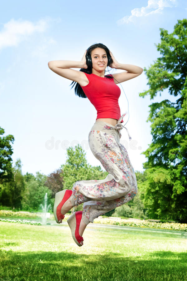 Download Happy Girl Jumping In Park Stock Images - Image: 20914234
