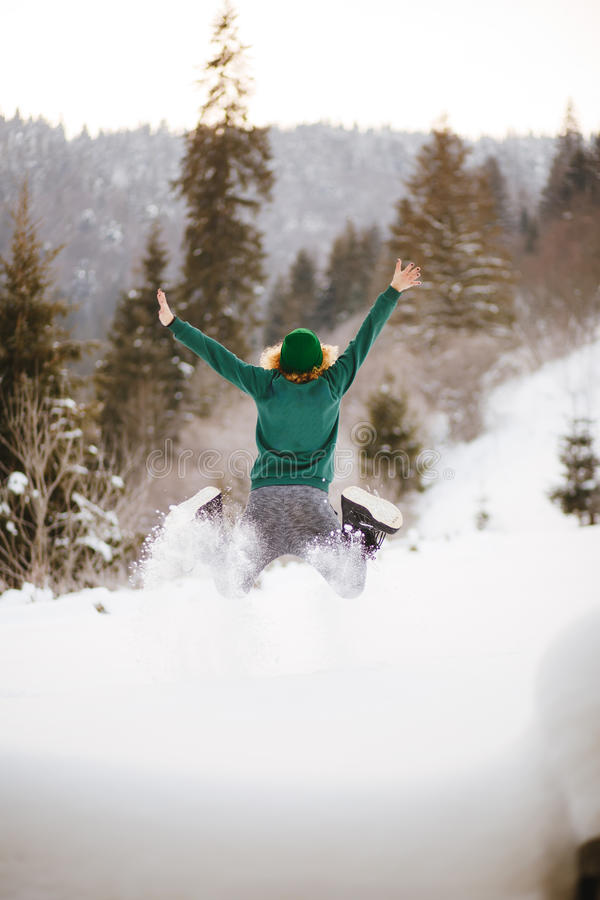 Download Happy Girl Jumping In The Winter Snowy Mountains. Stock Photo - Image: 83712550