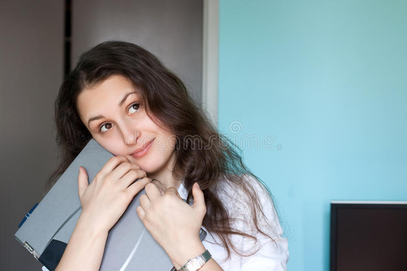 Happy girl with a laptop royalty free stock photo