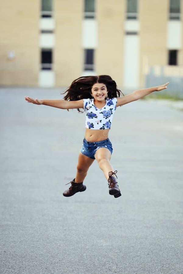 Happy girl last day of school stock photo