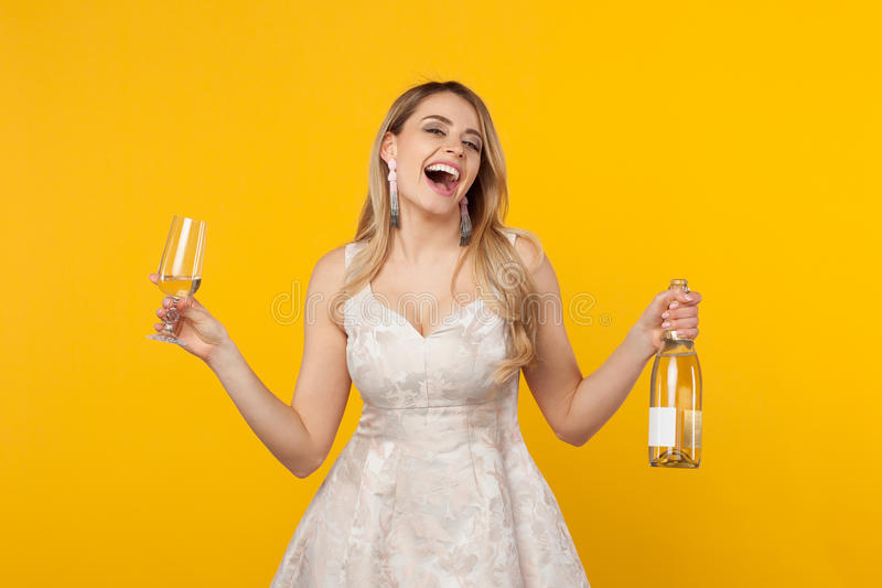 Happy girl laughing holding wine bottle royalty free stock photos