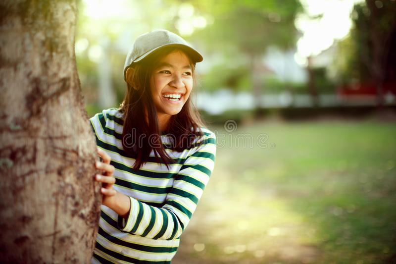 Happy girl. Laughing young girl enjoying her time outside in park with sunset in background royalty free stock images