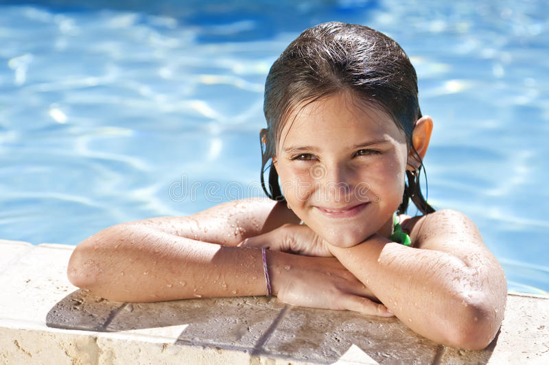 Download Happy Girl Leaning On The Edge Of A Swimming Pool Stock Photo - Image: 12743720