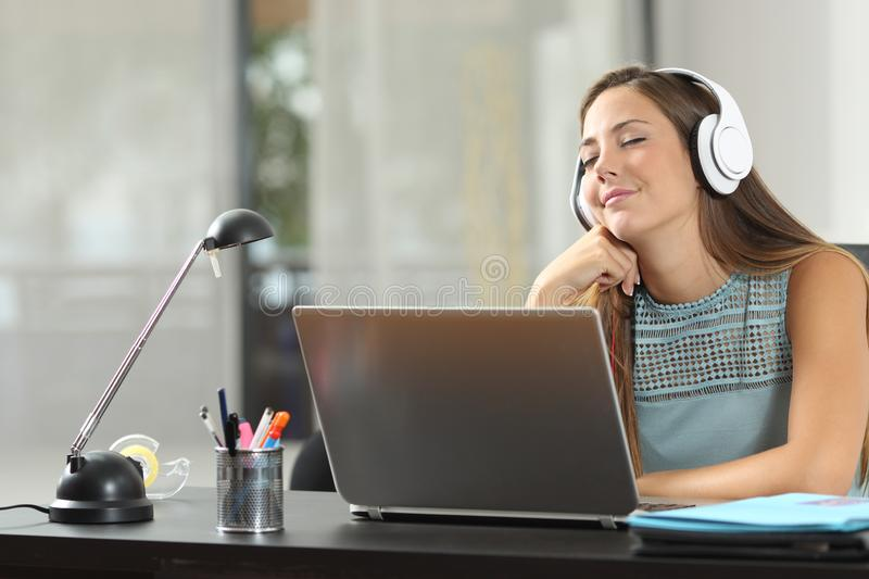 Happy girl listening to music with headphones stock photos