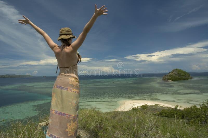 Happy girl on lonely island stock photos