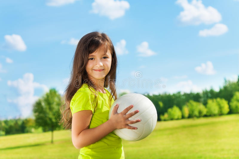 Happy girl with long hair and ball stock images
