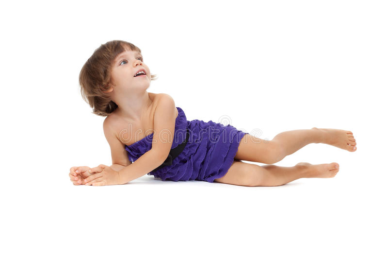 Happy girl lying on floor, isolated on white stock photo