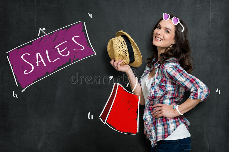 Happy Girl Makes Shopping. Joyful Beautiful Woman Doing Fashion Shopping Isolated On Grey royalty free stock photography