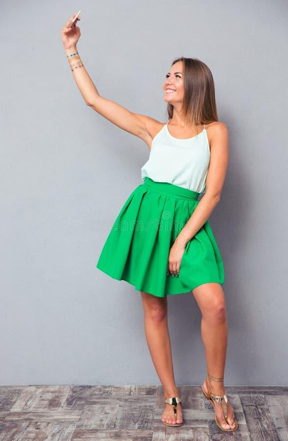 Happy girl making selfie photo stock images