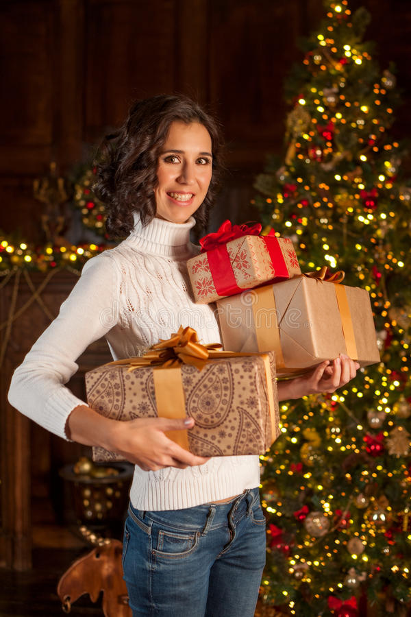 Happy girl with many Christmas gifts royalty free stock photography