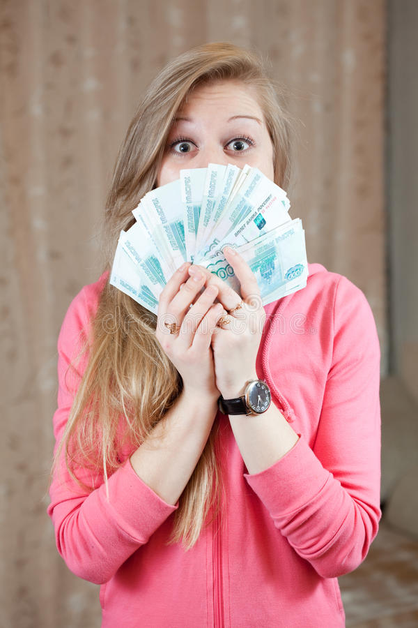 Happy girl with many roubles royalty free stock photos