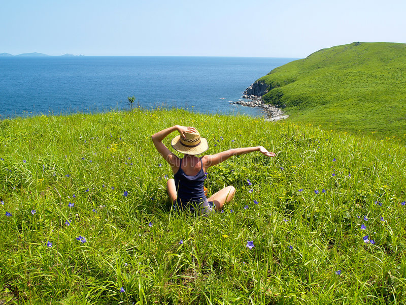 Happy girl on the meadow royalty free stock images