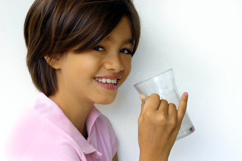 Happy girl with milk royalty free stock photography