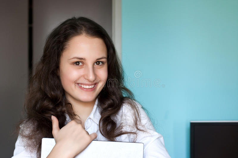 Happy girl with a notebook stock image