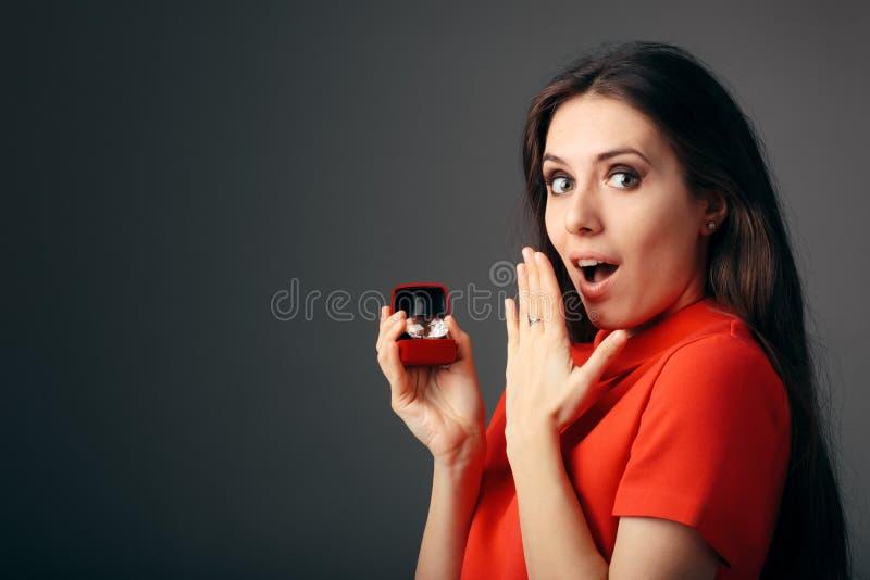 Surprised Woman Receiving Big Diamond in Gift Box royalty free stock photo