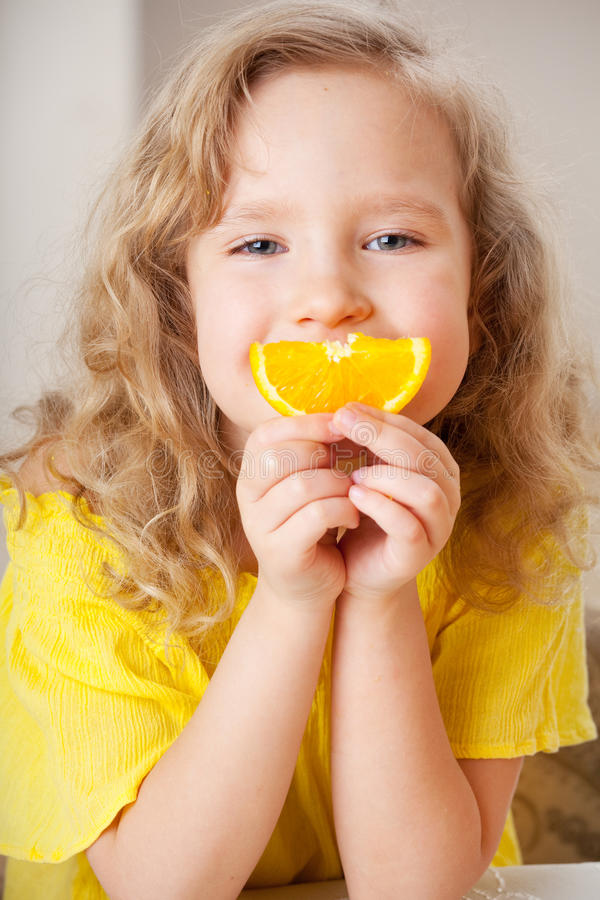 Happy girl with oranges stock photography
