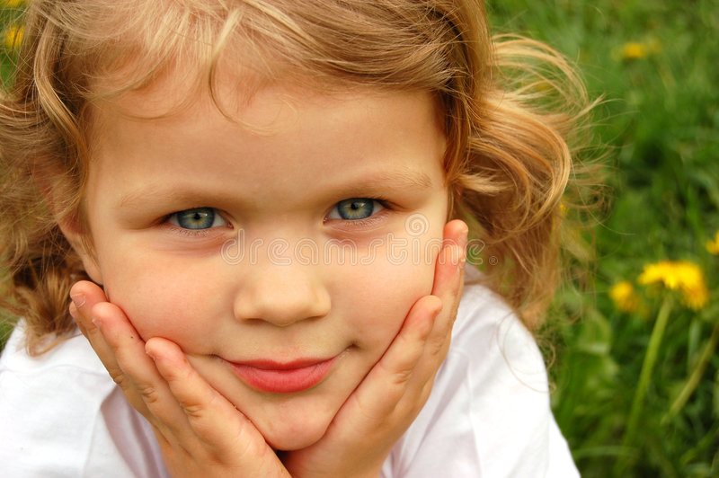 Happy Girl outdoors. A portrait of a happy young girl outdoors royalty free stock images