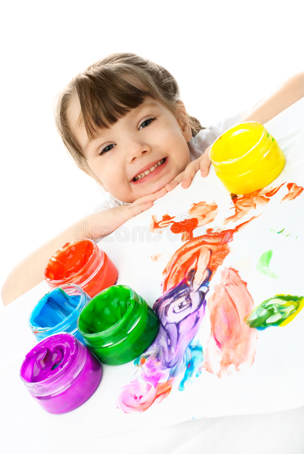 Happy girl painting with finger paints stock photography