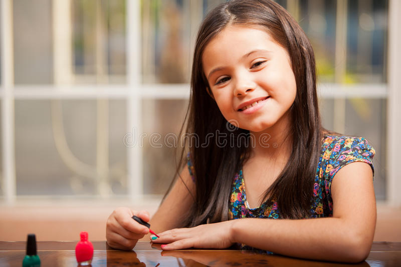 Download Happy Girl Painting Her Nails Stock Photo - Image: 34086070