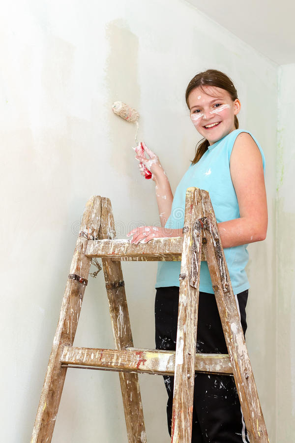 Download Happy girl paints wall stock photo. Image of work, house - 30666962