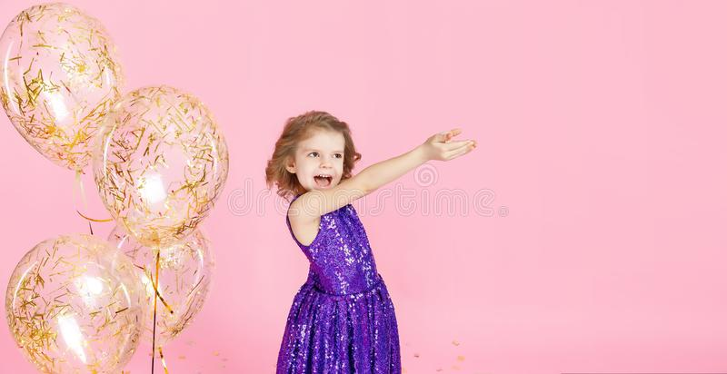 Happy girl in pink dress celebrating stock photography
