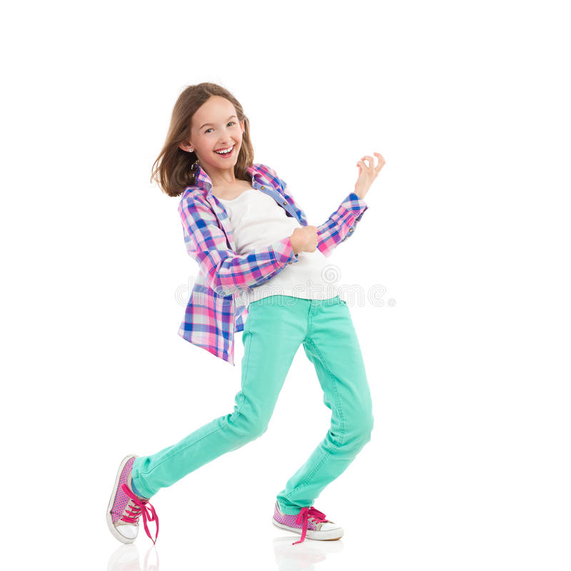 Happy girl playing the air guitar royalty free stock photos