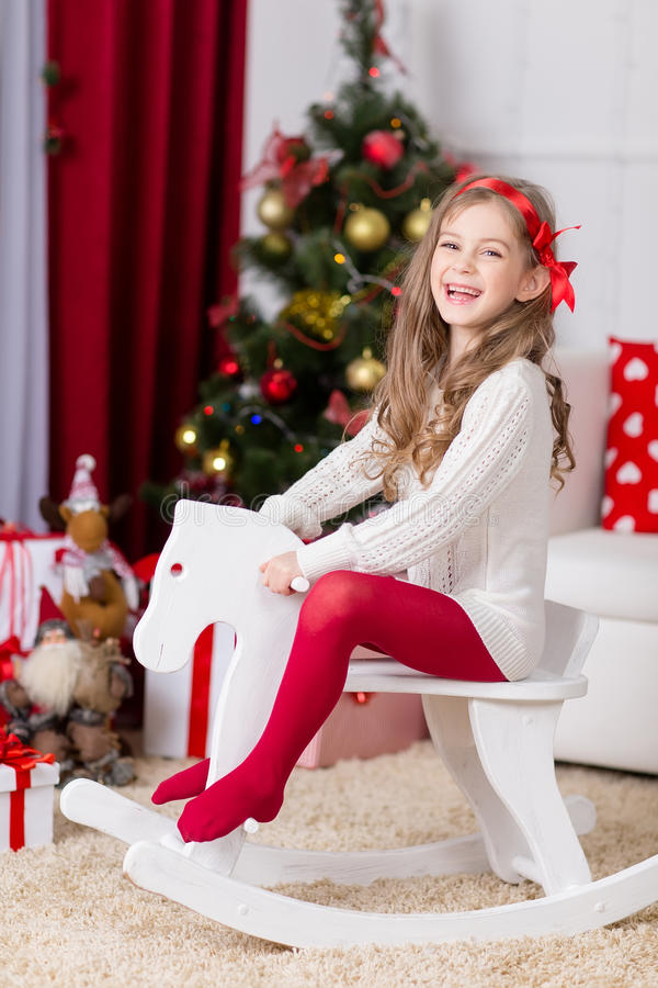 Free Happy Girl Playing In Christmas Decorated Room Royalty Free Stock Photos - 35495008