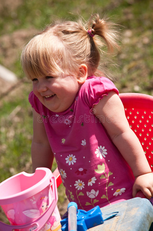 Happy Girl Playing Outdoors Royalty Free Stock Photos
