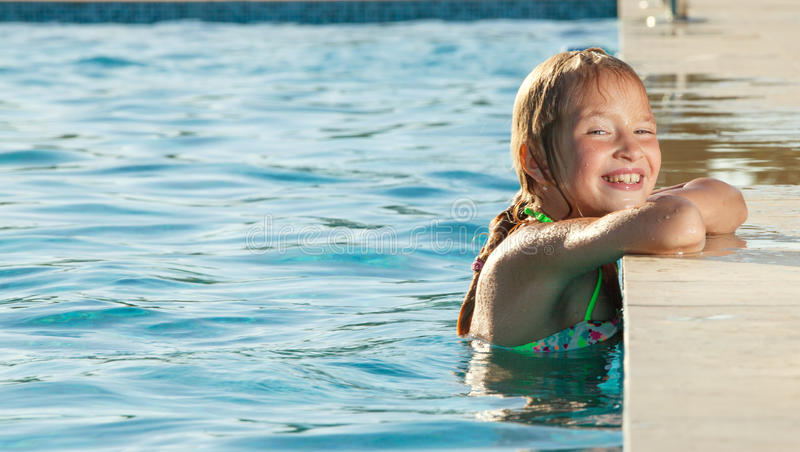 Happy girl at pool stock photo